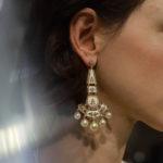 Model wears earrings from Zoya's Inheritance collection with Rahul Mishra's Metropolis II collection showing at Paris Fashion Week SS 2020